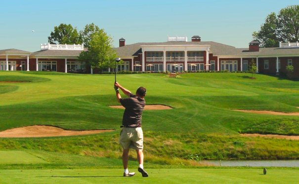 Man taking a shot toward the green at Old Hawthorne golf club