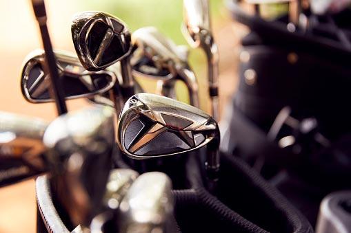 Clean golf clubs in golf bag