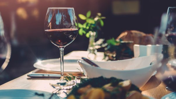 Table set with wine, salad, and other eats